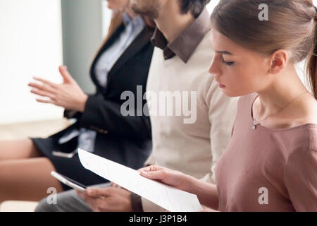 Young people waiting for job interview, audition or training ind - Stock Photo