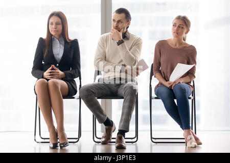 Waiting for job interview. Worried and nervous applicants sittin - Stock Photo
