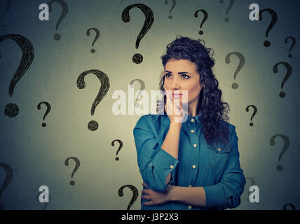 Portrait confused woman bewildered needs a solution has many questions isolated on gray background. Human face expression - Stock Photo