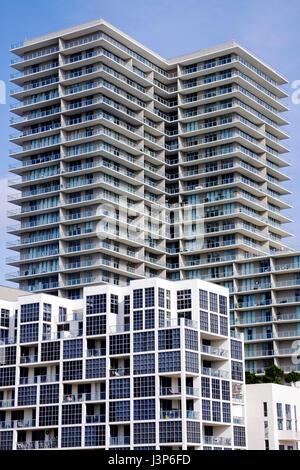 Miami Florida Midtown condominium condo apartments high rise building multi-story balconies modern architecture - Stock Photo