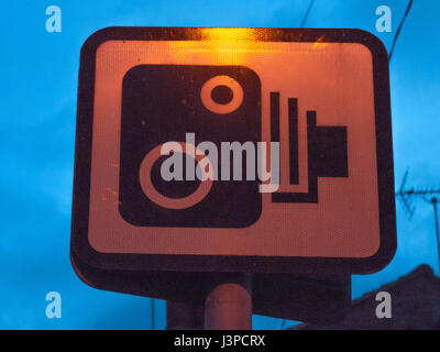a sign outside at night of cameras for speeding - Stock Photo