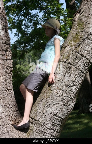 Young girl fancy dressed up in a tree - Stock Photo