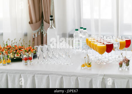 Restaurant Cocktail Tables in the Cocktail party. ice in a transparent glass bowl and metal sticking. festive buffet, - Stock Photo