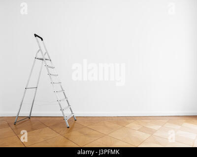 room with ladder and white wall background, renovated - Stock Photo