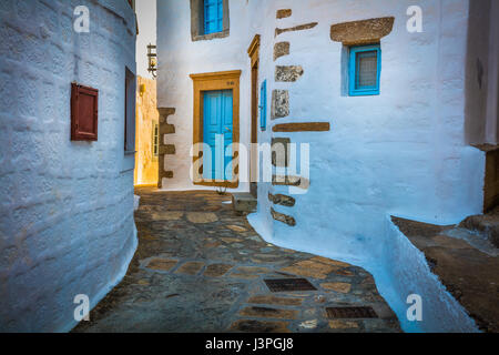 Street in Chora on the greek island of Patmos. Patmos is a small Greek island in the Aegean Sea. - Stock Photo