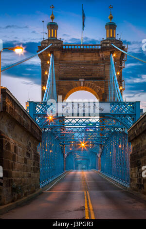 The John A. Roebling Suspension Bridge spans the Ohio River between Cincinnati, Ohio and Covington, Kentucky. When - Stock Photo