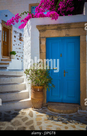 Doors and staircase in the Skala town of the greek island Patmos in the Skala town of the greek island Patmos - Stock Photo