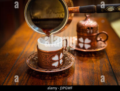 Turkish coffee (Turkish: Türk kahvesi) is a method of preparing unfiltered coffee. Roasted and then finely ground - Stock Photo