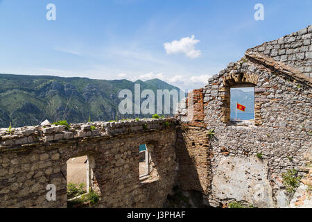 Flag of Montenegro seen through a gap in St John's fortress - part of the fortifications built around Kotor during - Stock Photo