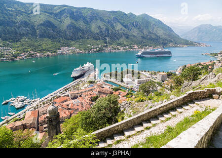 The Church of Our Lady of Health seen part way up the upper town walls above Kotor. - Stock Photo