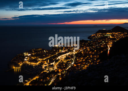 The ancient walled city of Dubrovnik situated at the foot of the Dalmatia region of Croatia jutting out slightly - Stock Photo