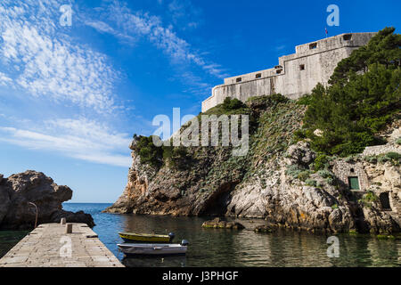 The triangular shaped Fort Lovrijenac jutting out into the Adriatic.  The walls facing Dubrovnik are only 60 centimetres - Stock Photo