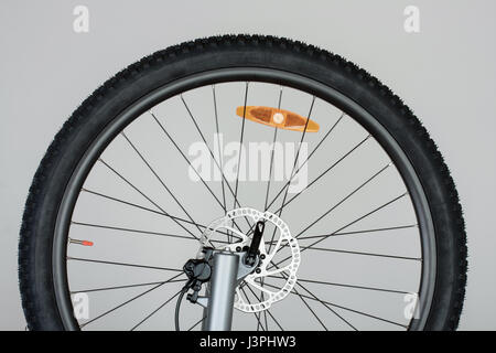 Part of front wheel of mtb bike with hydraulic disc brakes. - Stock Photo