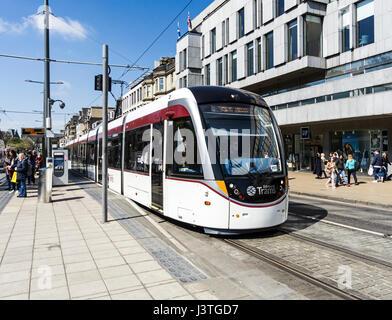 Transport for Edinburgh tram at Princes Street tram stop  in Edinburgh Scotland UK - Stock Photo