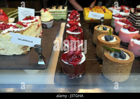 Luxury beautiful decorated rows of cakes and baked goods in the shop window of L'ETO Cafe Wardour Street,  Soho - Stock Photo