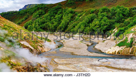 River in Valley of Geyser panorama with steamed holes - Stock Photo