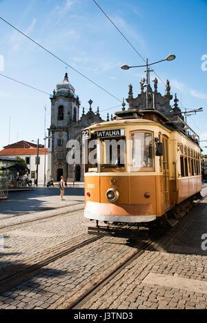 Old tram in front of church in Porto - Stock Photo