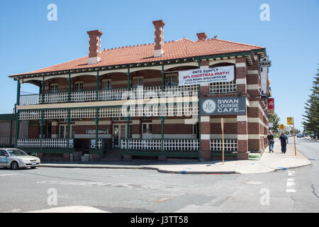 Fremantle,WA,Australia-November 13,2016:Old Swan Hotel building with cafe and tourists in downtown Fremantle, Western - Stock Photo