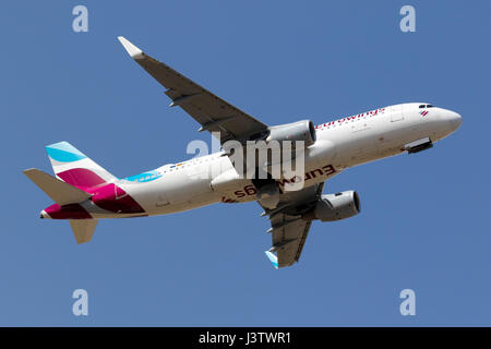 Eurowings Airbus A320-214 (WL) [D-AEWJ] on take off from runway 13. - Stock Photo