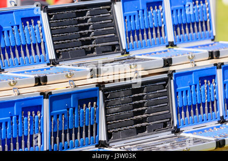 Boxes of drill bits for sale on a market stall. - Stock Photo