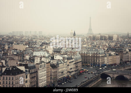 View of quai Saint-Michel and Paris in fog. France. - Stock Photo