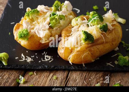 Healthy food: baked potato with broccoli, chicken and cheese close-up on the table. horizontal - Stock Photo