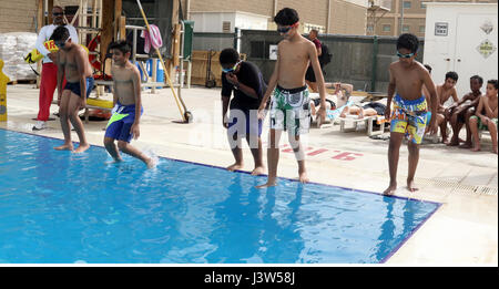 Boy Scouts of Troop 965 Kuwait eat pizza before the start of the ...