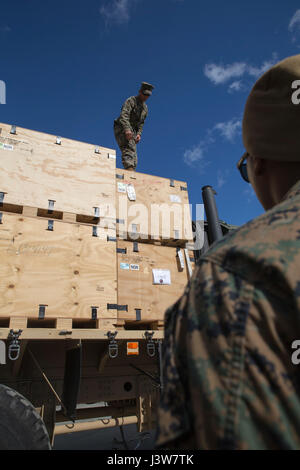 U.S. Marine Corps Cpl. Mohamed Hussain and Lance Cpl. Rodney Raber, motor vehicle operators with 2nd Transport Support - Stock Photo
