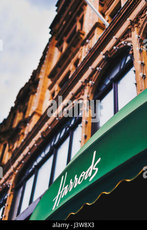 LONDON, UK - August 15, 2014: detail of the entrance of the historical Harrods department store in central London - Stock Photo
