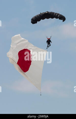 Evolve Aerosports executes a flag jump during the 41st Japan Maritime Self-Defense Force – Marine Corps Air Station - Stock Photo
