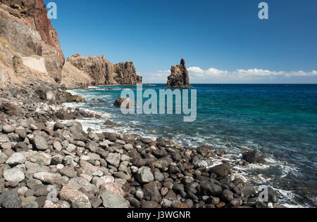 Rocky beach at Las Playas Bay looking towards the sea stack of Roque de la Bonanza, El Hierro, Canary Islands, Spain - Stock Photo