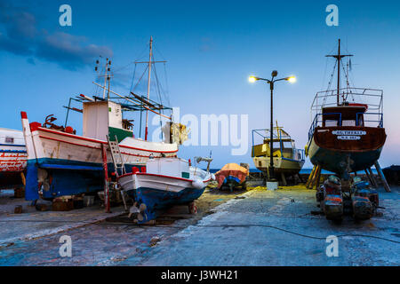 Dry docked boats in the harbor of Pythagorio town on Samos island, Greece. - Stock Photo
