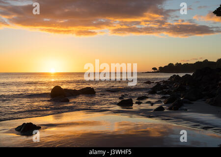 Beautiful sunset at Tamarin, seen from the beach of the Tamarina Golf & Spa Boutique Hotel in Mauritius. - Stock Photo
