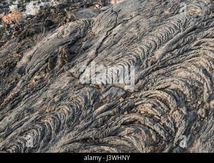 Basaltic lava flows with pahoehoe or ropy textures at Tacoron on the south coast of El Hierro, Canary Islands - Stock Photo