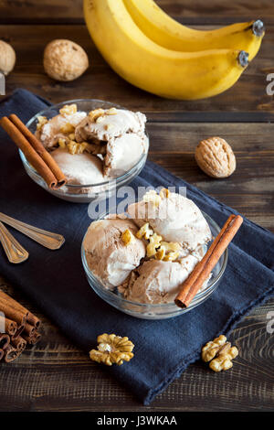 Healthy raw vegan banana and cinnamon ice cream (icecream, nicecream) with walnut topping - healthy vegetarian diet - Stock Photo