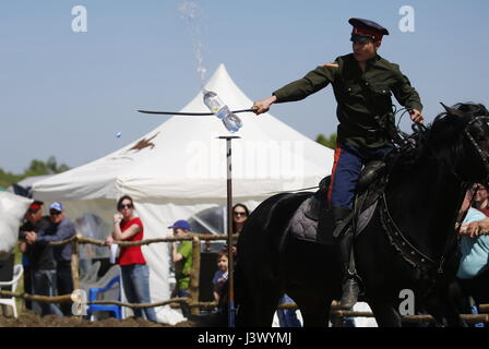 Rostov Region, Russia. 7th May, 2017. A participant sabre cuts water bottles at the Cossack national games, Shermitsii, - Stock Photo