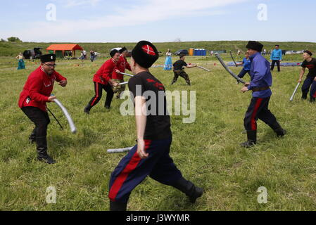 Rostov Region, Russia. 7th May, 2017. Participants in a fencing game at the Cossack national games, Shermitsii, - Stock Photo