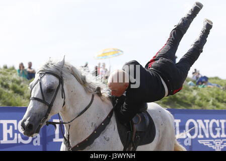 Rostov Region, Russia. 7th May, 2017. A participant performs stunts on horseback at the Cossack national games, - Stock Photo