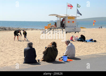 Dorset, UK. 8th May, 2017. UK Weather. People enjoy a sparkling sunny morning on Sandbanks beach Credit: stuart - Stock Photo