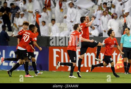 Doha, Qatar. 8th May, 2017. Rodrigo Tabata (1st R) of AL Rayyan celebrates scoring with teammates during the AFC - Stock Photo