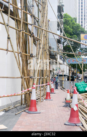 Bamboo scaffolding on an under construction building in Hong Kong. - Stock Photo