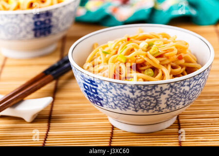 Mie noodles with a sweet and sour chili sauce - Stock Photo