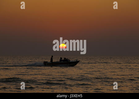 Sunset on the Cox's Bazar sea beach, the longest unbroken sea beach in the world. Cox's Bazar, Bangladesh. - Stock Photo