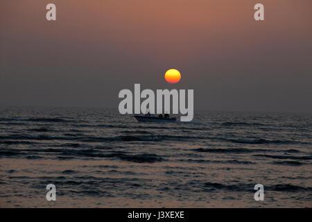 Sunset on the Cox's Bazar sea beach, the longest unbroken sea beach in the world. Cox's Bazar, Bangladesh. - Stock Photo