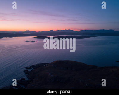 Aerial view of sunrise over the Scottish Highlands near Poolewe looking out over Loch Ewe towards Aultbea - Stock Photo