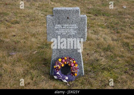 Grave of German stabsfeldwebel Antonius Düring (1903-1945) and two unknown German soldiers on the ground of the - Stock Photo