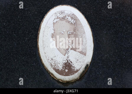 Badly damaged photograph of Soviet military officer Boris Mishenkov installed after World War II by his relatives - Stock Photo