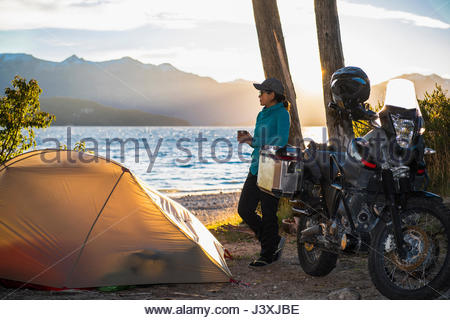 Woman relaxing at the Nahuel Huapi Lake in Patagonia - Stock Photo