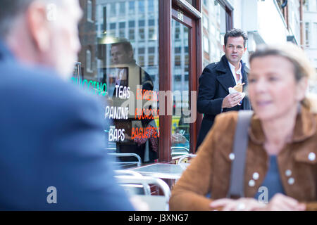 People at pavement cafe having lunch - Stock Photo