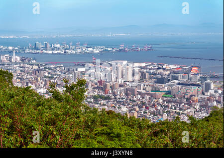 Aerial view of Kobe city and Port Island of Kobe from Mount Rokko, skyline and cityscape of Kobe, Hyogo Prefecture, - Stock Photo